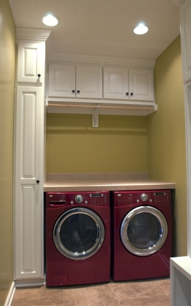 Small Laundry Room With Red Washer And Dryer