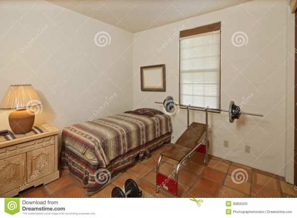 Best Small Single Bedroom With Bench Press And Weights Stock Photos Small Bench Press
