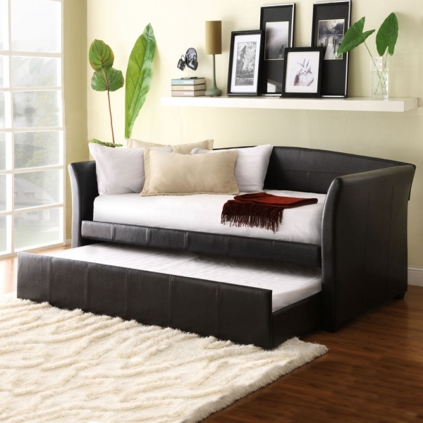Outstanding Furniture Maximizing Small Living Room Spaces With Black Leather Sleeper Sofa And White Cushions Plus Fold Out Bed Drawer Under Wood Wall Mounted Display Small Loveseats For Small Spaces